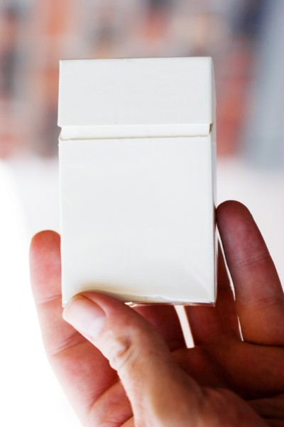 Blank cigarette pack in hand